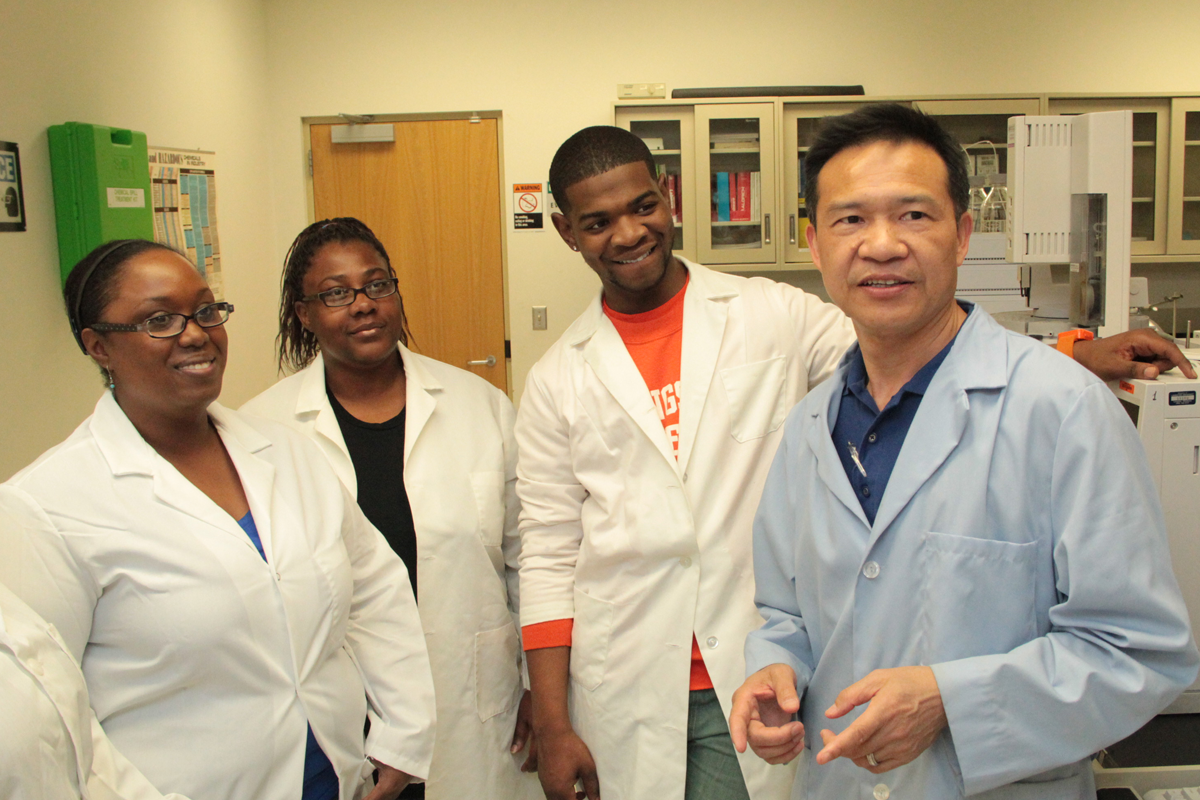 professor and students in lab coats